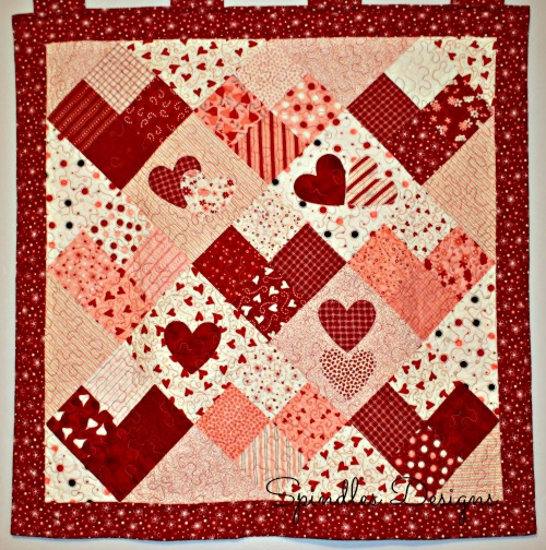 Quilt pattern by Quilting in the Rain. This Valentine's quilt was quilted by Spindles Designs. www.spindlesdesigns.com #valentinesdayquilt